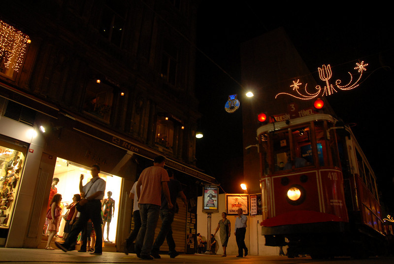 Trolley at night on Istiklal Caddesi (Independence Avenue), the main predominantly pedestrian shopping street, Istanbul, Turkey.