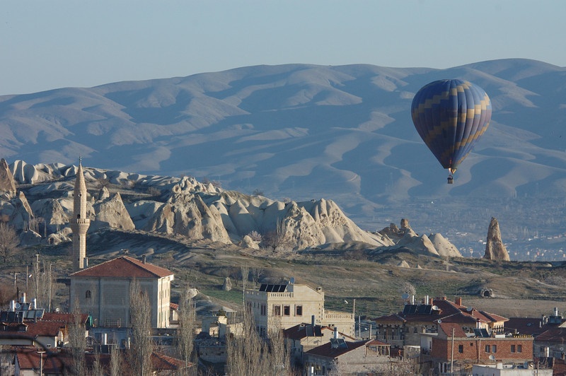Hot air balloon and mosque, Goreme, Cappadocia, Turkey.
