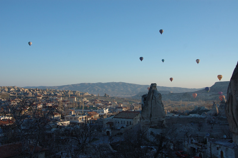 Balloons take off at dawn over Cappadocia, Turkey.
