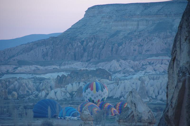 Inflating hot air balloons at dawn, Cappadocia, Turkey.