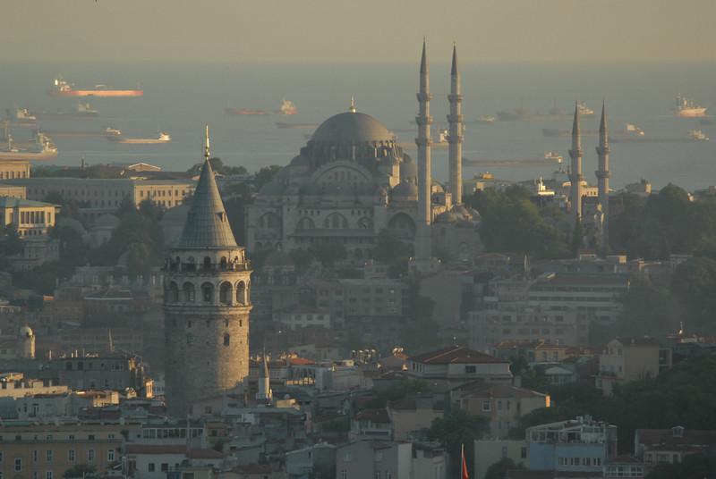 Galata Tower foreground, Suleymaniya Mosque and ships in the Sea of Marmara, Istanbul, Turkey.