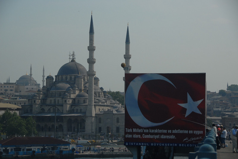 Suleymaniya Mosque, Eminonu docks and Galata Bridge over the Golden Horn, with fishermen, Istanbul, Turkey.
