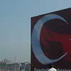 Billboard of Turkish flag and fisherman, Istanbul, Turkey.