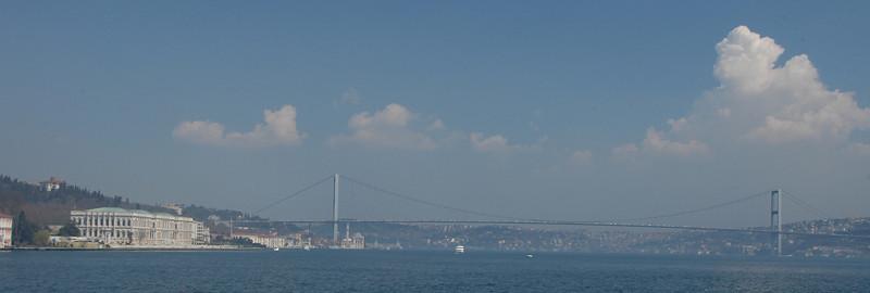 Dolmanbace Palace and Bosphorus bridge across the Bosphorus Strait, Istanbul, Turkey.