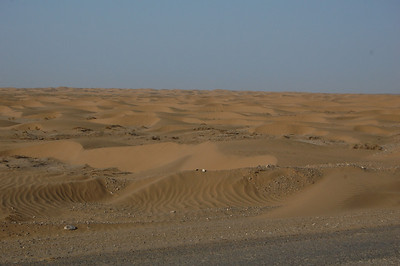 The desert moonscape turns to dunes which cause us concern as they start to drift across the road...