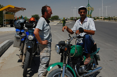 Out of the wilderness and getting closer to Ashgabat. A local 'biker' stops to chat and invites us for chai at his house.