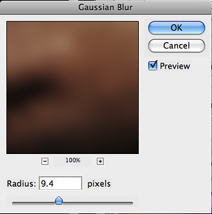 Select the top layer and go to Filter > Blur > Gaussian Blur, use a radius of 9.4.
