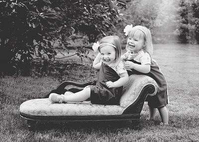Girls with Chaise Laughing bw (1 of 1)