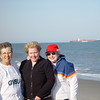 Sharon, Amy & Jeanne on beach with Container Ship in background.