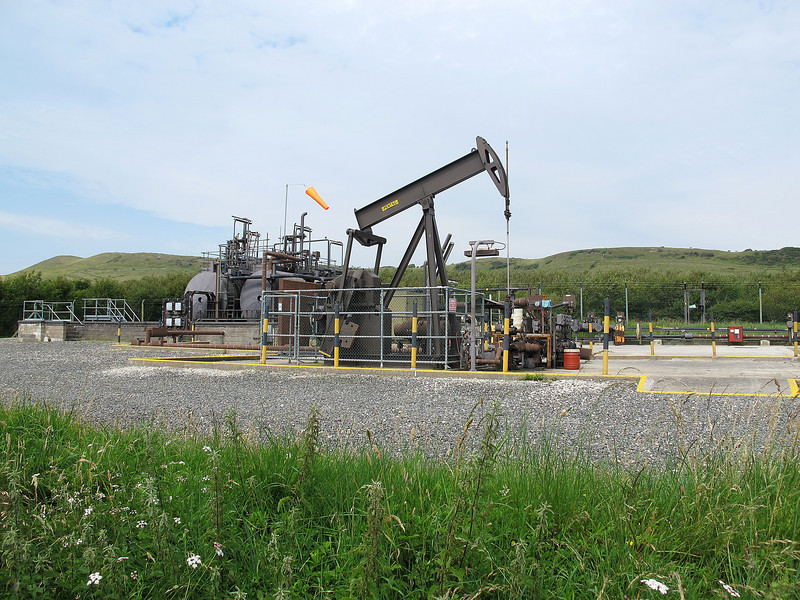 """The """"Nodding Donkey"""" at the end of Kimmeridge beach.   Oil is recovered from reserves in the folds above the oil rich shale."""