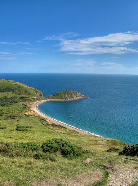 Up Rings Hill from Worbarrow bay to the iron age fort at Flower's Barrow, half of which has disappeared into the sea over the millennia.