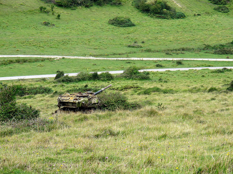 A target tank 'hull down' just to the side of the path near Arish Mell.