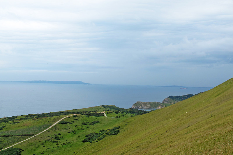 Lulworth Cove is in the middle distance with Portland at the far left.