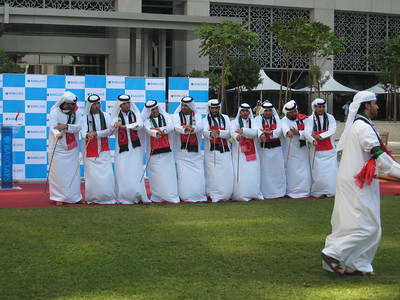 Emirati group performing al razeef at Emaar Square.