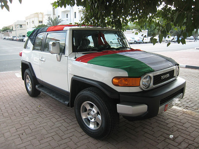 Our neighbour's car adorned with several UAE flags.