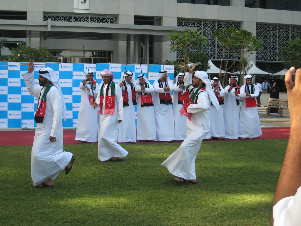Emirati group performing al razeef at Emaar Square.