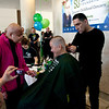 Cindy Chew<br /> 11/16/13<br /> Cancer patient Tori Rios, 14, holds her mom Terese's hand as she gets her head shaved in honor of her daughter at the St. Baldrick's Foundation head-shaving fundraiser event held at the Helen Diller Family Cancer Research Building at UCSF on Saturday.