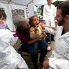Cindy Chew <br /> 7/23/12<br /> District 10 Supervisor Malia Cohen holds neice Rikki-Nicole Jones, 2, as Jones shows UCSF pediatric dental residents Jeremy Horst, right, and Sheila Nguyen, her teeth at the UCSF School of Dentistry children's free dental screening held during Sunday Streets Family Health and Wellness Fair in the Bayview on Sunday.