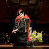 Cindy Chew<br /> 5/8/15<br /> Dean Joseph Guglielmo hoods the graduates at the School of Pharmacy Commencement at Davies Symphony Hall on Friday.