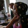 "Cindy Chew<br /> 8/13/09<br /> Rosa Nunez, right, gets a makeover from esthetics trainee Vanessa Barnhill at the San Francisco Institute of Esthetics and Cosmetology on Thursday.  Thirteen teenage girls, who are oncology patients at the Lucille Packard Children's Hospital, were treated to a ""Girls Day Out,"" complete with makeovers and lunch."