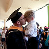 Cindy Chew <br /> 6/14/13<br /> Nursing School Graduate Daniel Linnen kisses his son Hendrik, 4, after the UCSF School of Nursing Commencement Ceremony held at Davies Symphony Hall on Friday.