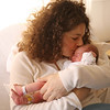 Cindy Chew<br /> 1/1/08<br /> Susan Waitkus kisses daughter Zoe, who was born at 1:12am on New Years Day at California Pacific Medical Center in San Francisco, weighing five pounds and 10 ounces.