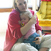 Cindy Chew<br /> 6/13/05<br /> Shasta Herndon holds fifteen-month-old daughter Mia at their temporary Sunset District apartment.  Mia is on the wait list at UCSF for a kidney and liver transplant.
