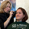 Cindy Chew<br /> 11/16/13<br /> Terese Calvo, whose 14-year-old daughter Tori has cancer, has an emotional moment as she prepares to get her head shaved at the St. Baldrick's Foundation head-shaving fundraiser event held at the Helen Diller Family Cancer Research Building at UCSF on Saturday.
