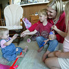 Cindy Chew<br /> 6/13/05<br /> Fifteen-month-old Mia Herndon, left, plays with brother Ethan, 3, mom Shasta, and sister Nyah, 6, at their Sunset District apartment on Monday.  Mia is on the wait list at UCSF for a kidney and liver transplant.