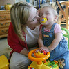 Cindy Chew<br /> 6/13/05<br /> Shasta Herndon kisses fifteen-month-old daughter Mia at their Sunset District apartment.  Mia is on the wait list at UCSF for a kidney and liver transplant.