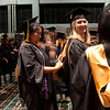 Cindy Chew <br /> 6/5/12<br /> Nursing student Sherry Lee Yamamoto helps Adrienne Franzese with her gown before the UCSF School of Nursing Commencement on Tuesday.