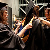 Cindy Chew <br /> 6/5/12<br /> Nursing students Stephania Poncia, left, and Sangchanh Trinidad, right, help Sara Megson with her gown before the UCSF School of Nursing Commencement held at Davies Symphony Hall on Tuesday.