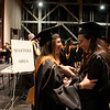 Cindy Chew <br /> 6/5/12<br /> Nursing students Margaret Buckwalter, left, and Anita Roberts fix their gowns before the UCSF School of Nursing Commencement on Tuesday.