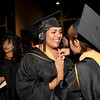Cindy Chew <br /> 6/5/12<br /> Nursing student Cynthia Antonio, right, helps Melissa Arreguin with her gown before the UCSF School of Nursing Commencement held at Davies Symphony Hall on Tuesday.