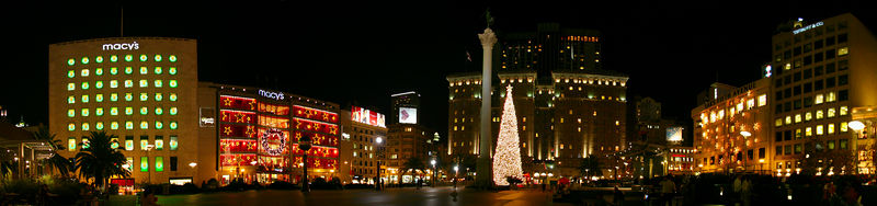 Union Square is the centre of San Francisco. Enrico Caruso sat in Union Square after his hotel was damaged in the 1906 earthquake. A few hours later he left, since fires were approaching the square. In this photo there are lots of Christmas decorations. The panorama stretches around to cover three sides of the four sided square: so the buildings are distorted to capture the wide angle.