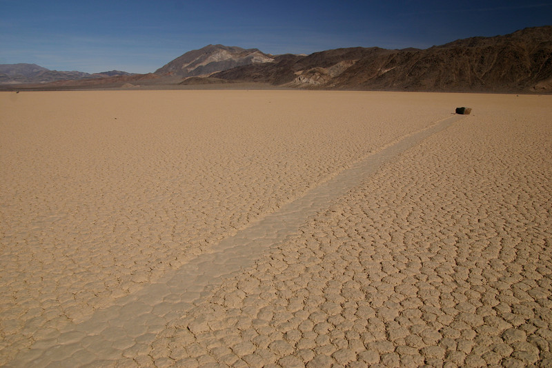 What causes large rocks to move across the dry lake bed at the Racetrack in Death Valley? There are some ideas, but no one really knows for sure...