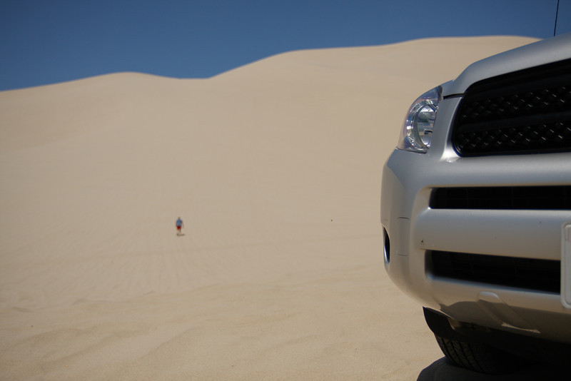 Dad decided to go climb the dune. I decided to stay and take a picture of him climbing the dune.