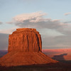 A butte casts an intriguing shadow over the desert floor at sunset