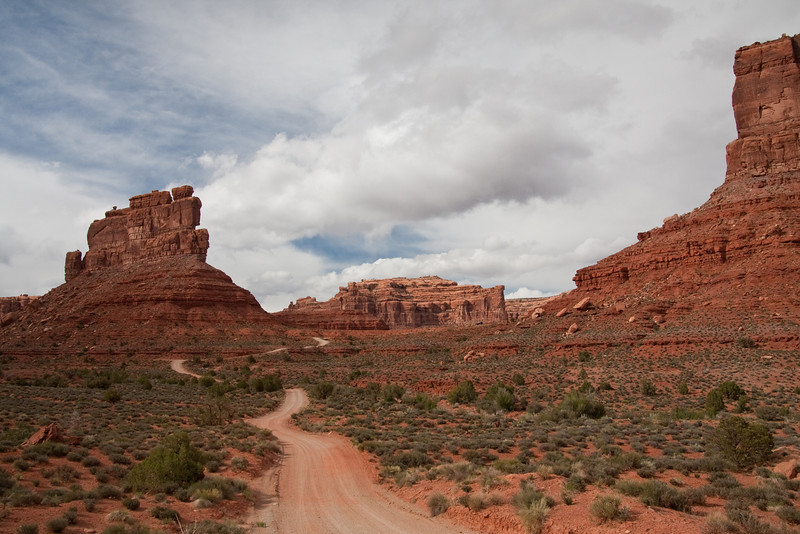 A dirt road takes you through the eerie buttes and mesas in Valley of the Gods, Utah