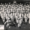 Photo submitted by Robert (Bob) Kempsell<br /> <br /> USNTC BAINBRIDGE RECRUIT BAND - July, 1954.<br /> <br /> Robert Kempsell SR - Company 101 - First Flute<br /> Joseph J. Corcoran - Company 101 - Sax <br /> Forrest E. Jordan - Company 101 - Sousaphone<br /> D. M. Arnold SR - Company 130 - Drum Major<br /> J. J. Polko SR - Company 117 - Band Leader<br /> J. B. Brunson BMC - Instructor<br /> C. T. Choplick SA - Instructor<br /> M. R. Schroeder SA - Instructor