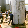 USS Simon Lake (AS-33) lifting a Trident I Missile loading tube out of the missile magazine. 1980 Kings Bay, GA