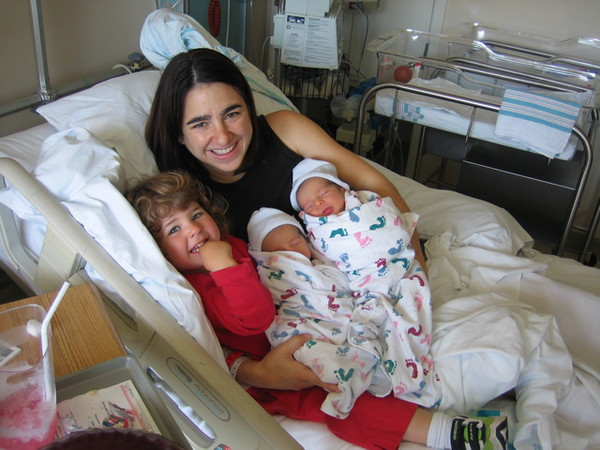 Megan, Anabella, Huck, and Milo <br /> Megan with her new twin boys. Big beautiful babies. Milo weighed in at 7 lbs 7 oz and Huck was only slightly smaller at 7 lbs 6 oz. All, as you can see, are doing well.