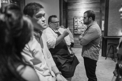 Underbelly,Houston, TX, 2012  Owner/Chef of Underbelly, Chris Shepherd, talks to JohnP while we wait to be seated. Look at Johnp's face and body language.