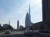 The tall needle-like tower is Burj Khalifa.