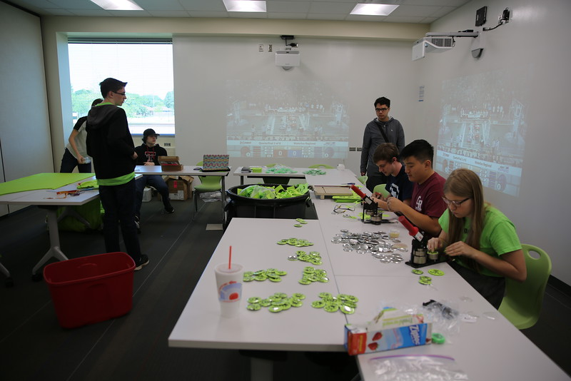 ALso 2016, students working on team PR projects, using the projectors to watch other tournaments going on in other states.