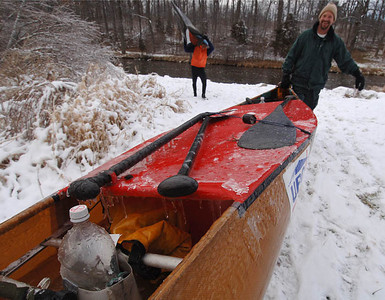 Mike Garon of Mt Clemens carries his frozen racing canoe back to his truck after training on the Huron River in the dead of winter.  Paddlers train year round to compete in the AuSable Canoe Marathon in late July in Grayling every year.