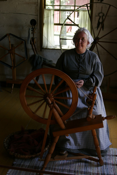 I guess she is spinning wool...