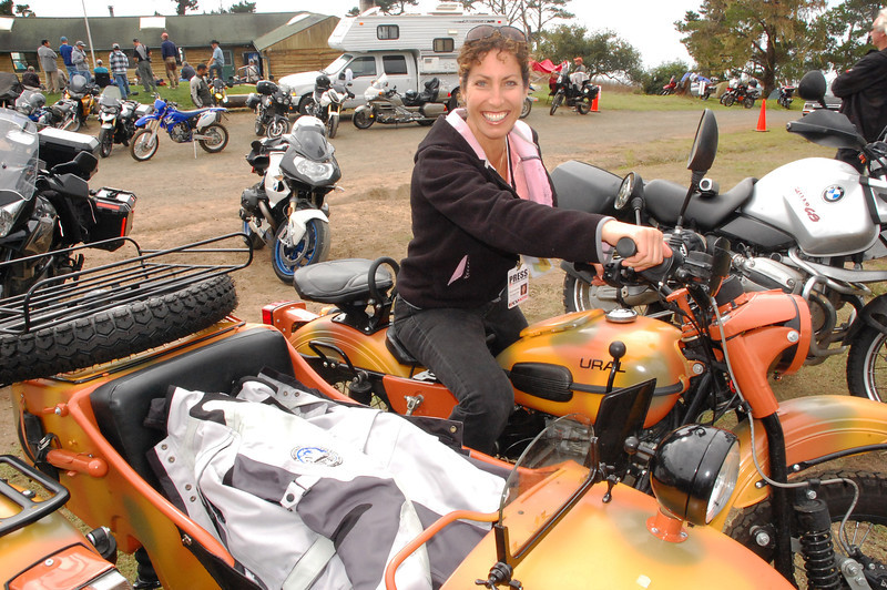 Nicole is thrilled with sampling a fellow Horizons Unlimited 2011 enthusiast's Ural.