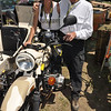 Mark Tetreau shows Nicole Espinosa the ins and outs of the Ural Gear-Up.