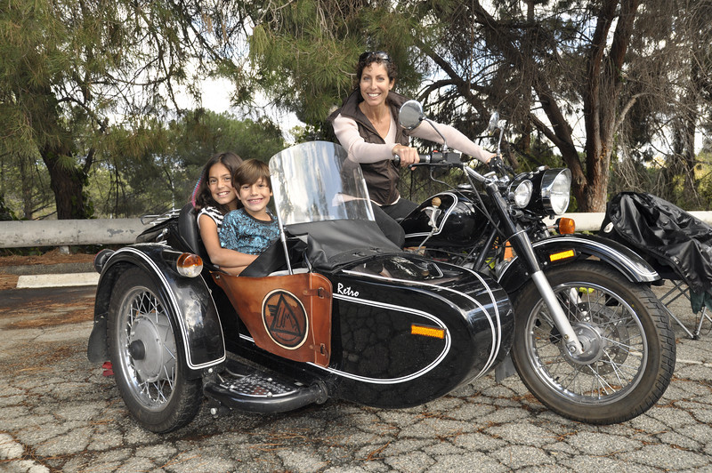 Excited mom, Nicole Espinosa, gives her kids, Alana and Dimitri, a taste of what it will be like to go around the world in a Ural at the Griffith Park Sidecar Rally 2011.